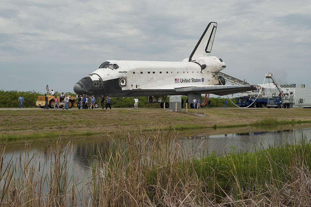 STS-135: Space Shuttle towed off runway for final time in ...